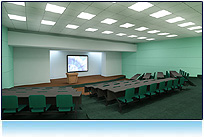 This impressive lecture hall showcases a large stage flanked by two video screens. It's a perfect for educational or technical video.